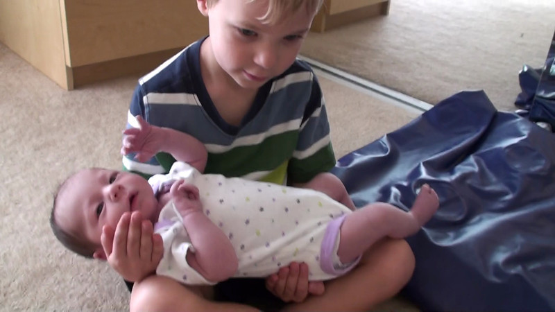Nolan holding his sister for the first time