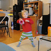 Dancing and playing the tambourine. I know he doesn't match...