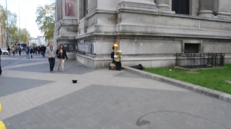 Interesting tuba player outside the Science Museum