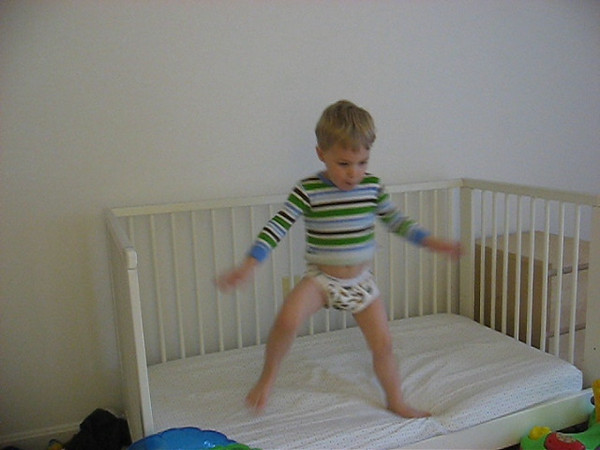 Nolan dancing on the bed