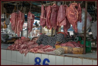A Nap at the Meat Market in Sa Dec, Vietnam.