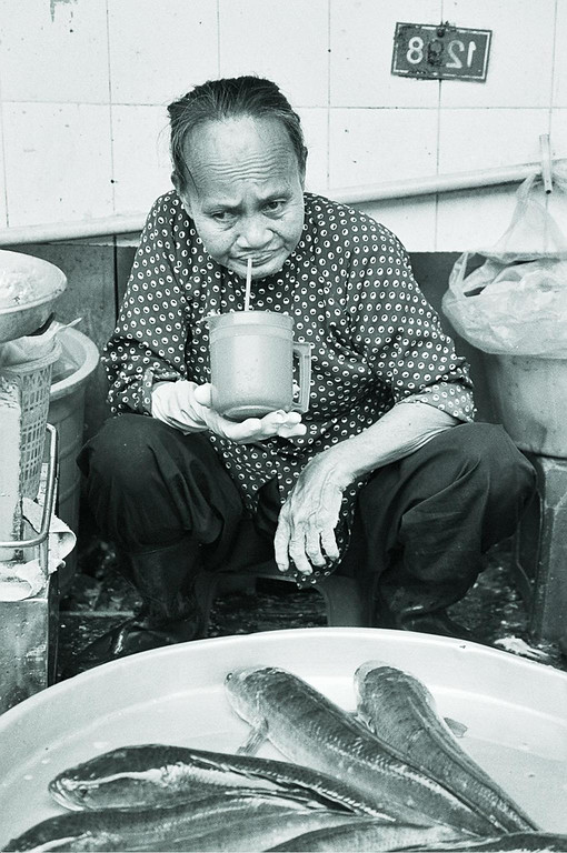 old lady with mug and fish