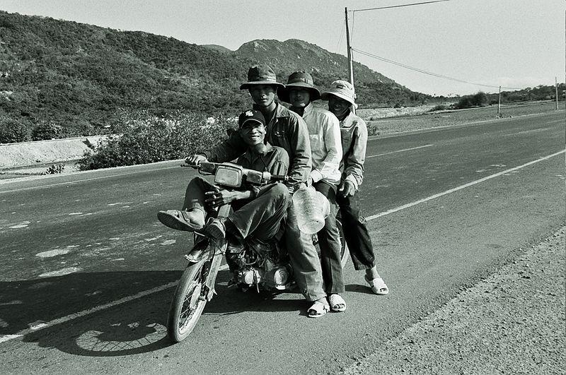 4 men on moped