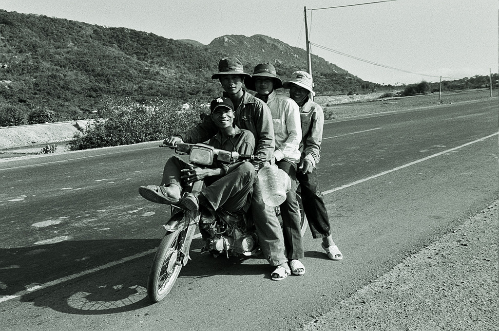 4 men on moped