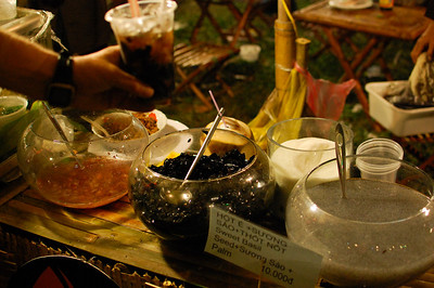 James is persuaded to try a traditional Vietnamese drink containing black slime and what looks like frog spawn (centre and right).