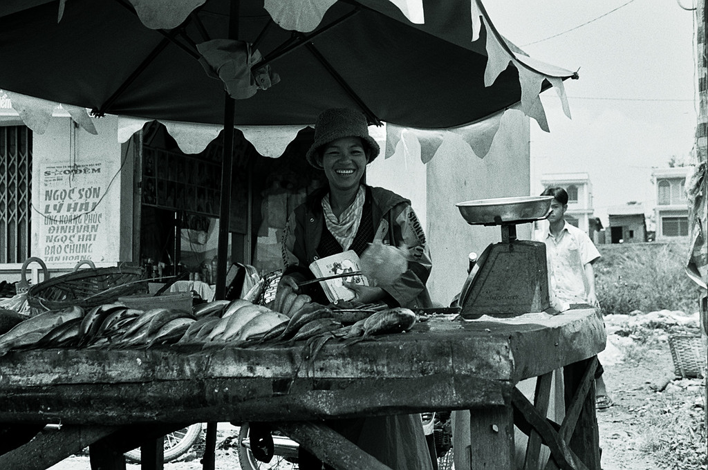 fish seller with fly swat