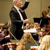 William LaRue Jones conducts a symphony