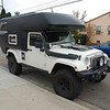 Mario's tricked out Jeep with Action Camper and snorkel.