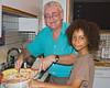 Mario teaching Mollee Donovan to make pasta.