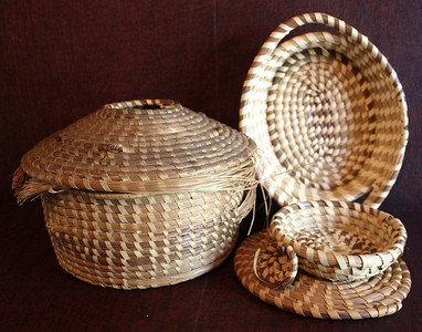Sweetgrass, including older sweetgrass sewing basket on left (needs some repairs.)