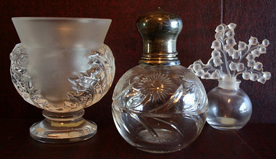 Lalique left and English cut glass perfume with sterling top and Lalique style bottle on right.