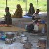 Another group of attendants cooking outside