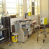 Inside operating theatre.The only anaesthetic machine we have EMO, next to it are two oxygen cylinders, recently supplied after an incident.Empty ether bottles for EMO anasthetic placed on window sill.One oxygen concentrator only works with powerThe only suction machin on small table.