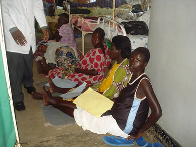 Inside maternity ward, all the beds are full, most mothers lie on the floor with their babies, on mats or large polythene papers.Sitting on the floor are admitted mothers with their charts waiting to be reviewed by the doctors on ward round.