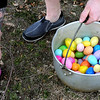 Church volunteer Shelby Walker hides eggs for the younger egg finders  on Saturday, April 19, 2014. (Pioneer Press: Sherri LaRose-Chiglo)