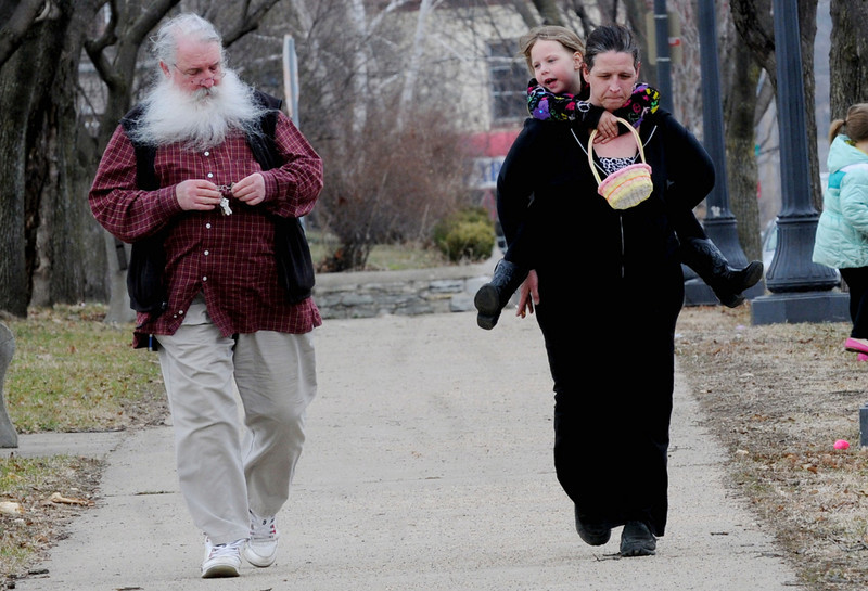 In Dayton's Bluff, residents Shelly Smetana and her daughter Kloe Hollerbach,6, walk a few blocks with Kloe's grandfather Jim Smetana to the annual Easter egg hunt. (Pioneer Press: Sherri LaRose-Chiglo)