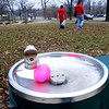 Church volunteers from Mounds Park United Methodist Church prepare for the annual Easter egg hunt with an egg in the park water fountain. (Pioneer Press: Sherri LaRose-Chiglo)