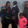 Hmong women and a child in the cold in Sapa, Vietnam in January 2012