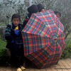 Hmong women with an umbrella in Sapa, Vietnam in January 2012