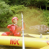 Rebecca paddling a duckie down the Nantahala River