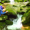 Rebecca photographing small waterfall.