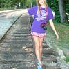 Rebecca balancing on railroad track III