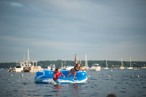 Cousins Abby and Tanner flying off the giant floating party bar!
