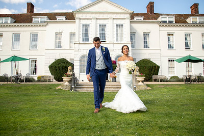 The bride and groom at Gosfield hall for their wedding photos