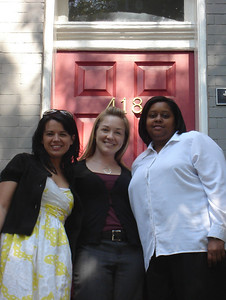 Erin Saiz Hanna, Aisha S. Taylor and Maria A. Noel stand outside the new office of the Women's Ordination Conference in May 2008.
