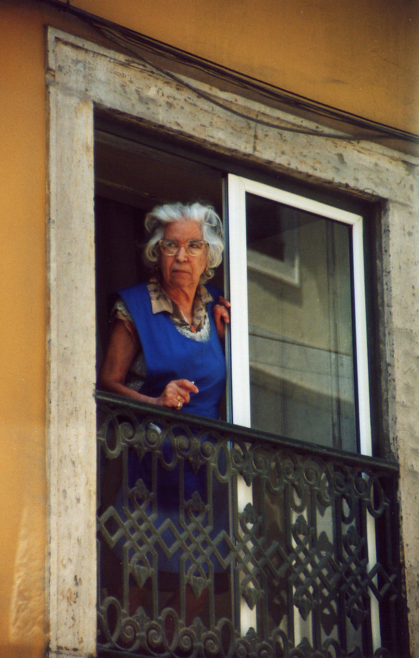 Woman on balcony, Lisbon, Portugal