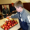 Adam Engleman grabbign an organic apple from Hotchkiss in the John and Lois Roberts Room<br /> <br /> Photo by Chris Rourke
