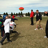 Joseph Lozano throws a pass during the kids football camp at Western.<br /> <br /> Photo by Chris Rourke