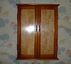Susan's necklace wall case - mahogany w/ birds-eye maple panel doors - designed like a shallow 'medicine chest'.