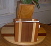 Napkin holder made for my kitchen - mahogany + white pine + walnut glued and then cut attached to a walnut base - nicely matches the other objects on the table.