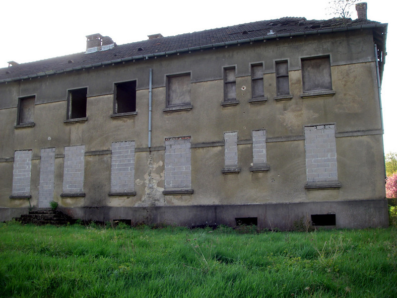 One of two remaining barracks buildings at old French Garrison, Legeret, along Highway D38 (Photo taken April 2011).