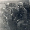 Corporal Randy Minix (left) and Dad, France, November 1944.  Notice who is working, and who is smoking a cigarette.