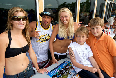 Wakeboarders Melissa Marquardt, Chad Buechler and Ashly Becker sign autographs with fans Ben Browner and Calvin Acker at the Wake Nation Grand Opening