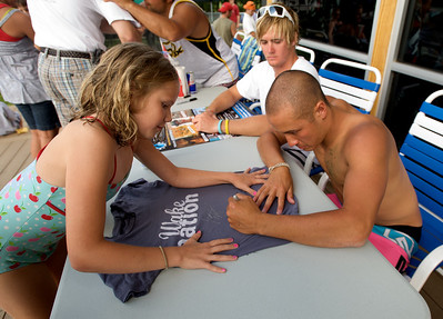 Sophie Hartmann gets a Wake Nation T-shirt autographed by Wakeboarder Clayton Uderwood at the Wake Nation Grand Opening