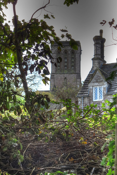 Kingston church tower rises behind a row of cottages.