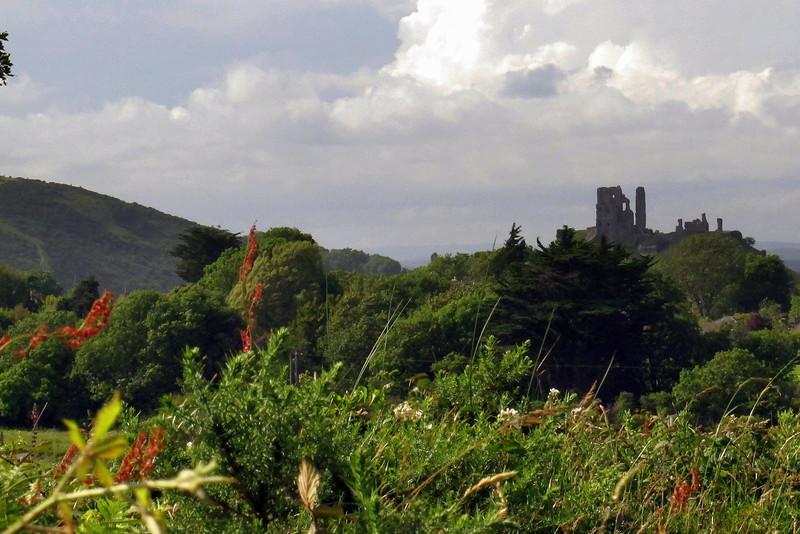 Atmospheric ruins of Corfe Castle loom above the surrounding heathland.