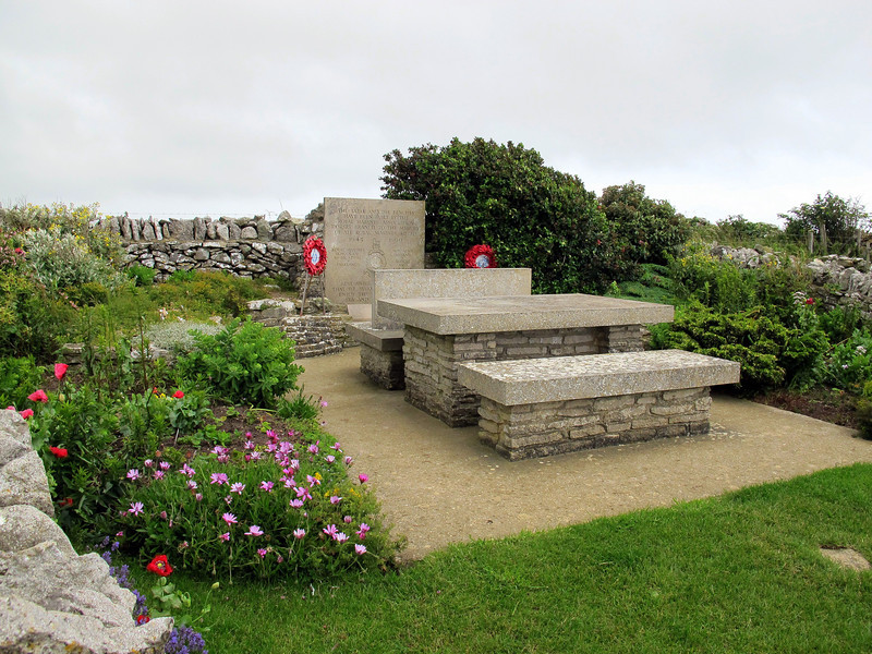 The charming Royal Marines Memorial, consisting of stone picnic table and benches,<br /> on the cliff top at St Aldhelm's Head, Dorset