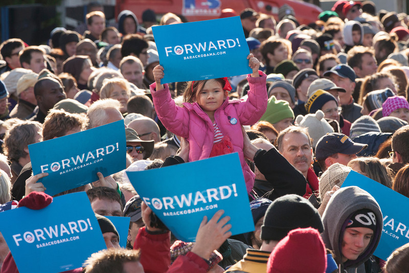 November 4, 2012 Concord, NH.  At a rally to reelect President Barack Obama 2 days before elections, a young girl center holds up a sign in support of the president with his slogan Forward on it.  According to CNN there was approximately 14,000 people in attendance at the rally. Photo by Katherine Taylor