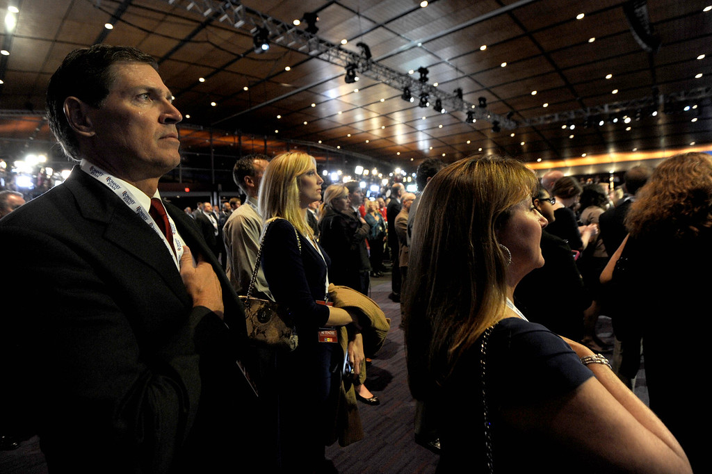 Nov. 6, 2012 - Mitt Romney supporters recite the Pledge of Allegiance in the ballroom of the Boston Convention Center, the site of the Romney-Ryan headquarters on election night. Photo by Billie Weiss.