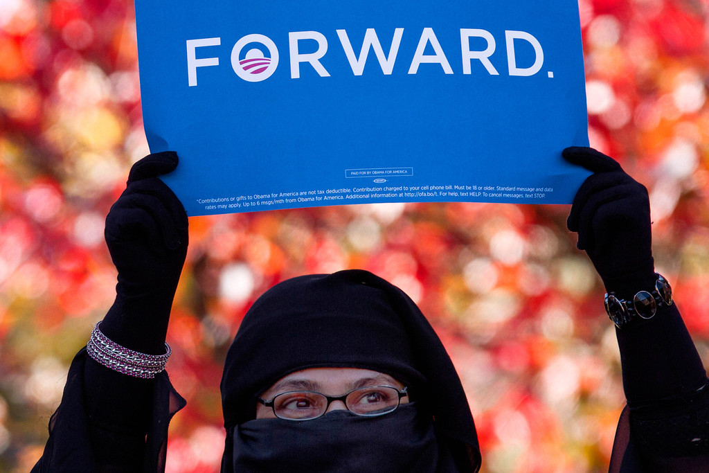 Oct. 18, 2012 - A supporter holds up a campaign sign as President Barack Obama speaks at campaign event at Veteran's Memorial Park in Manchester, New Hampshire. Photo by Billie Weiss.