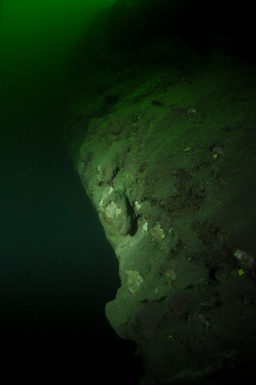 Bottom ledge located at a depth of 65 feet.