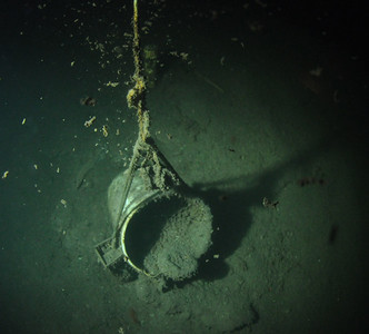 Plastic bucket filled with concrete, used to anchor down line decompression line.  Depth 115 feet