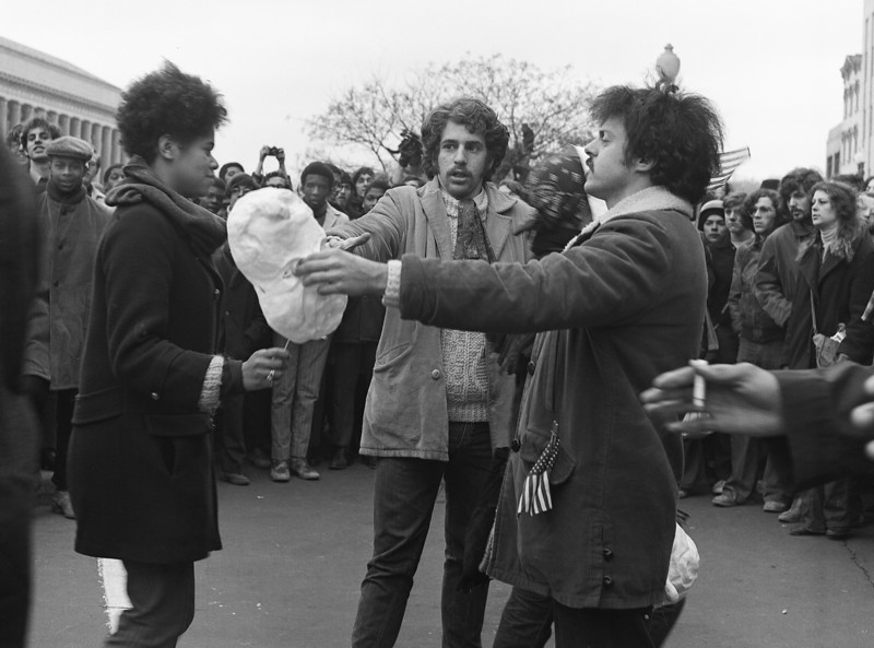 Great irony and meaning is expressed in street performances protesting Nixon's rise to power. Was it the man in the center who became an elected official in Colorado?