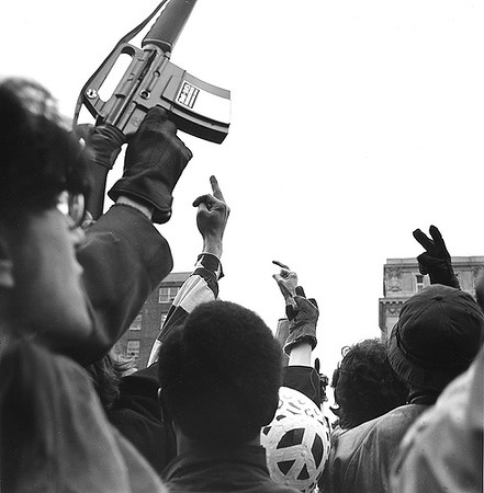 Something is always happening in D.C. Bart Calpsaddle and I use our DIA credentials to get to the heart of the local action. This shot is taken at the January 1969 Inauguration of Richard Nixon. The victory sign mixed with the finger and the toy gun reflects the mood. The protesters are taunting the police with toy guns and firecrackers. Nixon passes, snarles at the crowd. As the presidential limo approaches, I scamper to a high point. I balance on a tree planter and frame Nixon's sneer with these symbols. For a brief moment I see the the most amazing photograph of the era. A demonstrator throws firecrakers at Nixon,  and the police charge. I miss the shot and instead fall into the crowd to be trampled. The first wave of feet over me are the sandles and tennis-shoe clad feet of the protesters. Next come the polished brogans of the D.C. police, and finally I feel jack boots of the National Guard. In the fetal position, I protect my cameras.