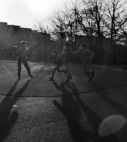 There's a spirit one can capture at 1/125th of a second in the long evening shadows. Forever these boys play football. And forever their stride is long, breath is deep, and forever keen the Fall air.
