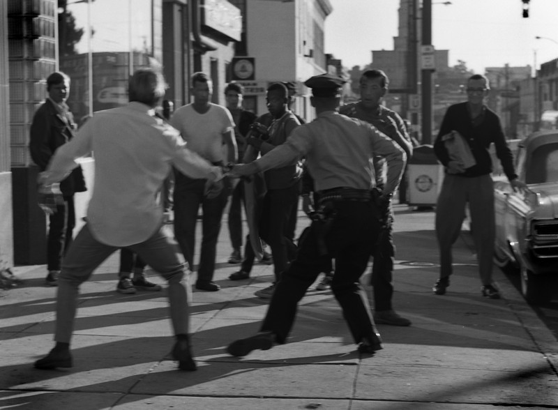 One day in a bad Alexandra neighborhood a brawl breaks out in front of a local bar. A young cop comes by and breaks up the fight by handcuffing himself to one of the pugilists. Big mistake he soon finds as he's now attached to a barroom brawler. I capture his awful moment.